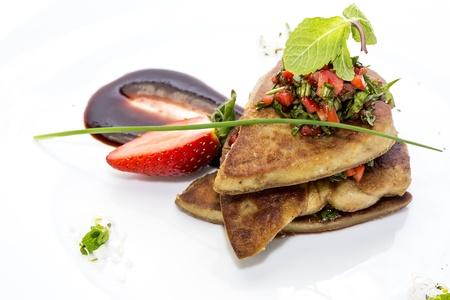 foie gras garnished with strawberries Stock Photo