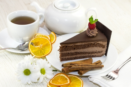 dessert, a piece of cake on the table with a cup of tea photo