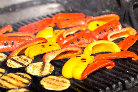 cooking vegetables on the grill in the restaurant photo