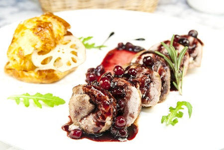 meat with cranberry sauce on a table  photo