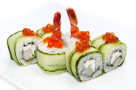 maki: Japanese rolls in a restaurant with fish and vegetables