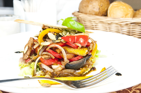 salad with vegetables and meat on  restaurant photo