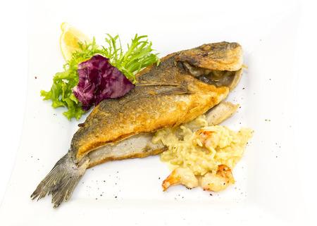 Fried fish dorado with vegetables and lemon Stock Photo - 22858719