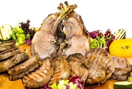 loin and steak cooked on a grill with vegetables photo
