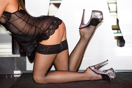 part of the body of the girl dancing striptease Stock Photo