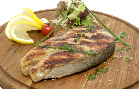 Grilled salmon fillet with vegetables and photo