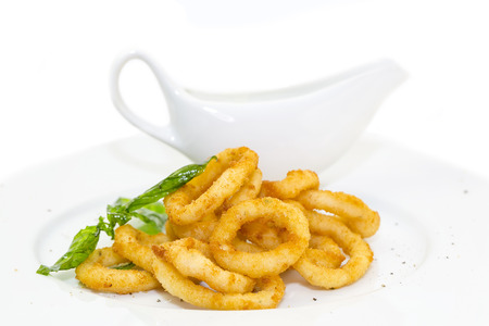 fried calamari rings on a white background