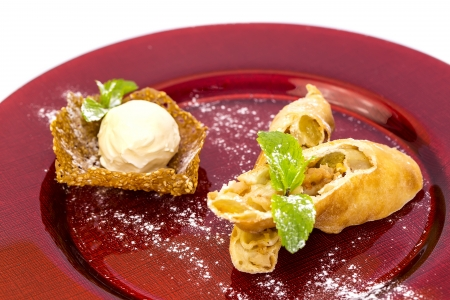 strudel with ice cream on a white background in restaurant photo