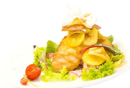 salad with chicken and potatoes on a white plate in a restaurant photo