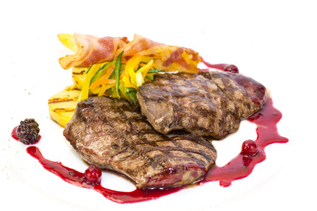 steak with tomato sauce and mushrooms on a white background in the restaurant photo