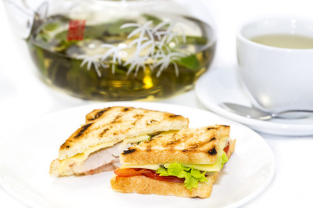 sandwich with tea on a white background in restaurant photo