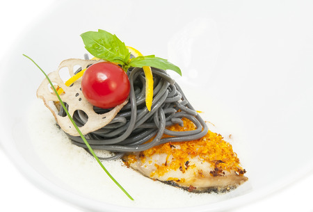 baked fish with black and white spaghetti sauce Stock Photo - 23824348