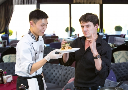 chef and the customer in a restaurant with Japanese food photo