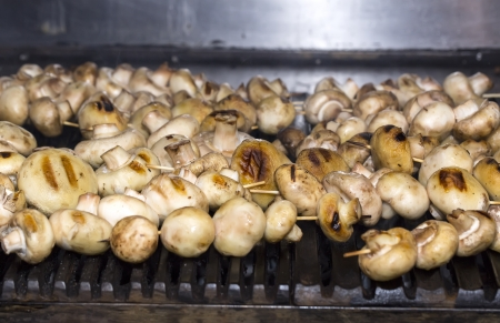 mushrooms grilling in the kitchen at the restaurant photo
