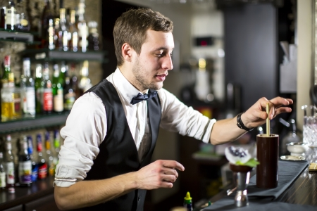 young man working as a bartender in a nightclub bar Stok Fotoğraf