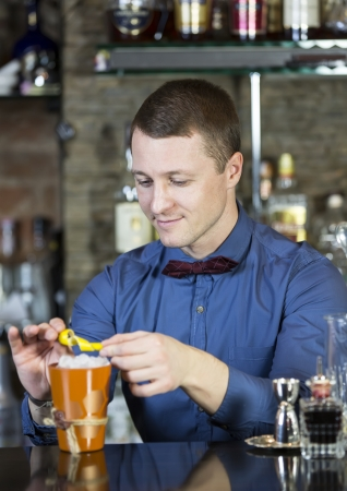 nightclub bar: young man working as a bartender in a nightclub bar Stock Photo