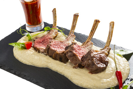 lamb ribs cooked on the grill served on a hot stone Stock Photo - 24620684