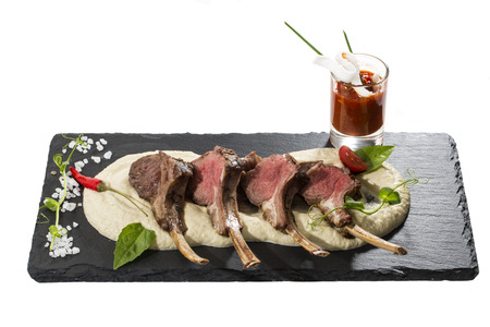 lamb ribs cooked on the grill served on a hot stone Stock Photo - 24620685