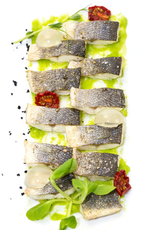 baked black cod fish on a white background in the restaurant photo