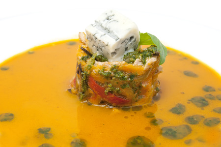 Mexican soup with vegetables and cheese in a restaurant photo