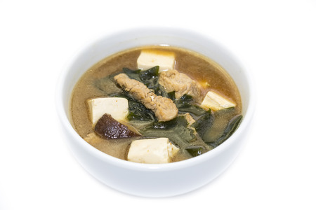 Japanese soup with mushrooms and beef on white background photo