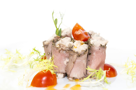 appetize: meat rolls with cheese decorated with tomato