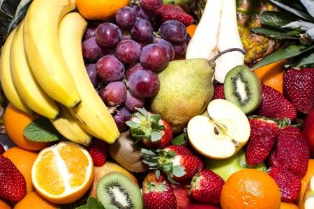background of ripe fruit apples oranges grapes photo