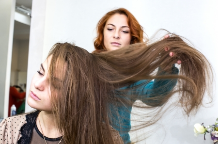 woman in a beauty salon doing hair