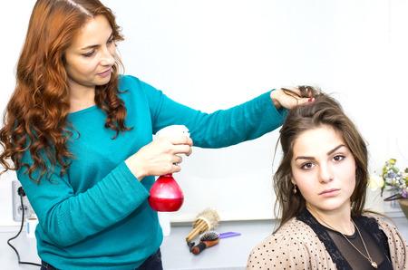 woman in a beauty salon doing hair photo