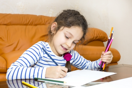child drawing: children draw with crayons on paper Stock Photo