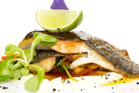 baked fish with vegetables and mushrooms in a restaurant photo