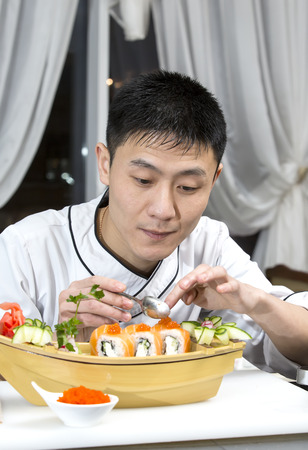 Japanese chef preparing a meal in a restaurant photo