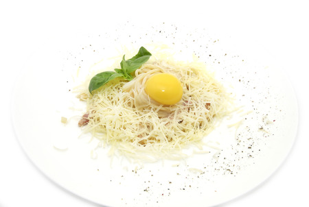 mani: spaghetti with egg and cheese on a table in a restaurant