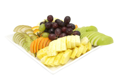 plate of fruit with exotic fruits on white background photo