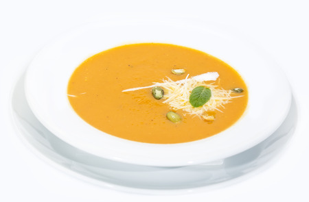 pureed: pumpkin soup on a white background in the restaurant