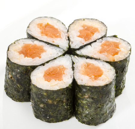 philadelphia roll: sushi with seafood and vegetables on a white background in the restaurant
