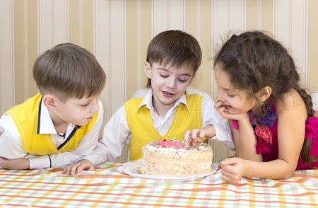 kids have fun eating birthday cake photo