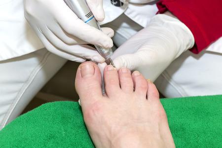 process of pedicure at beauty salon photo