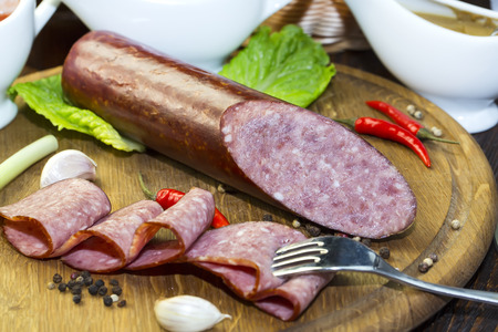 sausage on a wooden plate in a restaurant photo