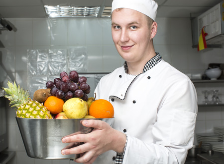 chef preparing food in the kitchen at the restaurant photo