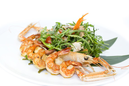 shrimp salad greens vegetables and crayfish in the restaurant photo