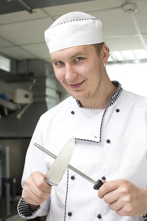 whites: chef preparing food in the kitchen at the restaurant