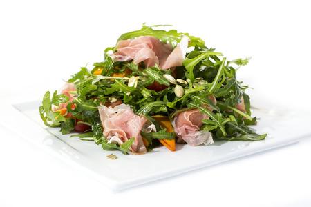 salad of arugula ham cheese on a white background photo