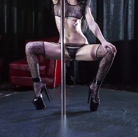 female stripper: part of the body of the girl dancing striptease Stock Photo