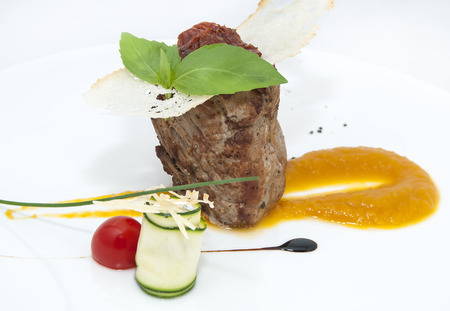 Roast beef with gravy in a restaurant on a white background photo