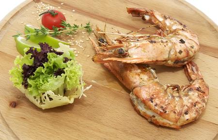 hoisin sauce: Grilled Shrimp with Orange on a wooden plate
