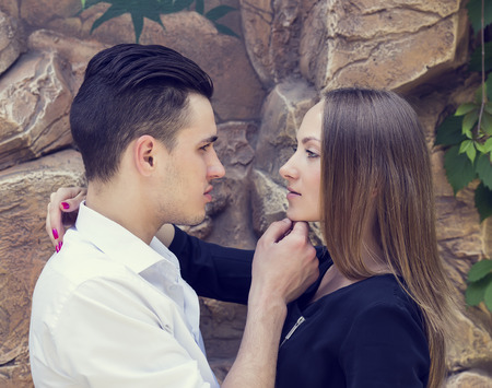 portrait of a loving couple on nature in park photo