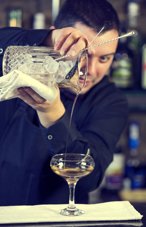 non alcoholic beverage: young man working as a bartender in a nightclub bar Stock Photo