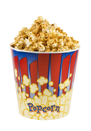 popcorn in a glass on a white background