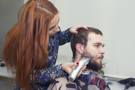 young man in a barber shaved shorn photo